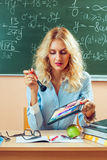 Beautiful young teacher making-up Royalty Free Stock Photography