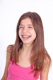 Beautiful young teen girl with brackets. On teeth in white Royalty Free Stock Photo