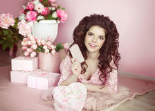 Beautiful young teen girl holding mobile phone. Brunette with fl Stock Images