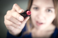 Beautiful young teen girl holding red lipstick Royalty Free Stock Photos