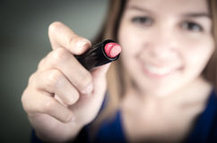Beautiful young teen girl holding red lipstick Stock Photography
