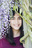 Beautiful young teen girl under wisteria vines Royalty Free Stock Photo