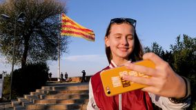 Beautiful young teen tourist with Barcelone flag on the background. Amazing Barcelone, Spain. Happiness stock footage