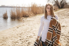 Beautiful young teenage caucasian woman in a plaid walking think Royalty Free Stock Image