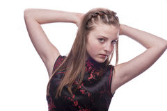 A beautiful young teenage girl. Photo of a nice looking young teenager posing isolated on a white background Royalty Free Stock Image