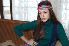 Beautiful young teenage girl hippie posing in room Stock Photos