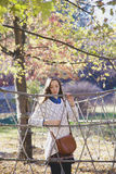 Beautiful young teenage girl posing near a rope fence Royalty Free Stock Photography