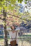 Beautiful young teenage girl posing near a rope fence Royalty Free Stock Photos