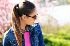 Beautiful young teenage girl posing on spring background. Stock Photography