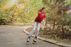 Beautiful young teenage girl roller skating Royalty Free Stock Photography
