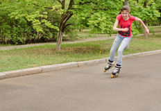Beautiful young teenage girl roller skating Royalty Free Stock Photos
