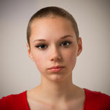 Beautiful Young Teenage Girl With A Shaven Head Stock Photography