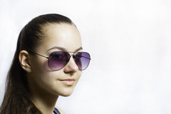 Beautiful young teenage girl in sunglasses over white background Royalty Free Stock Images