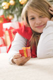 Beautiful young teenage in red comforter Royalty Free Stock Images