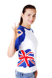 Beautiful young teenage woman showin ok gesture. Royalty Free Stock Photo