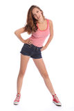 Beautiful young teenager girl in denim shorts Royalty Free Stock Photo