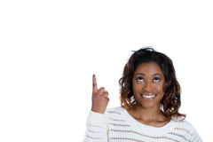 A beautiful young teenager with her index finger pointed upwards Royalty Free Stock Photos