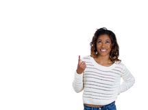A beautiful young teenager with her index finger pointed upwards Royalty Free Stock Images