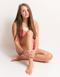 Beautiful young teenager sitting on the ground Royalty Free Stock Photos