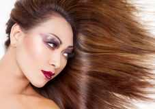 Beautiful young Thai woman with long elegant straight hair Royalty Free Stock Photo