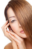 Beautiful young Thai woman with long elegant straight hair Stock Photography
