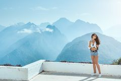 Beautiful young tourist girl with backpack at mountains Stock Images