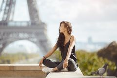 Beautiful young tourist girl near the Eiffel tower. stock images