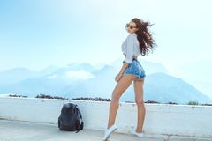 Beautiful Young Tourist Girl With Backpack At Mountains Stock Photography