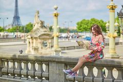 Beautiful young tourist with map Royalty Free Stock Photos