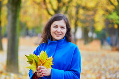 Beautiful young tourist in Paris on a fall day. Beautiful young girl in the Luxembourg garden of Paris on a fall day royalty free stock photos