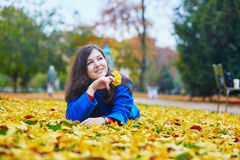 Beautiful young tourist in Paris on a fall day Royalty Free Stock Photo