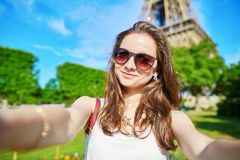 Beautiful young tourist in Paris taking selfie Stock Photo