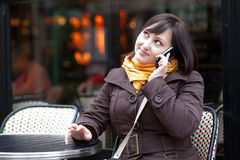 Beautiful young tourist in Paris talking by phone Stock Photo