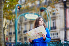 Beautiful young tourist in Paris Stock Images