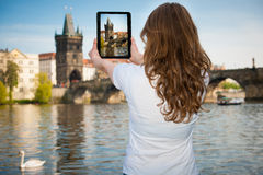 Beautiful young tourist woman photographing sites in Prague Czec Stock Image