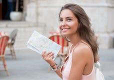 Beautiful brunette tourist woman. Royalty Free Stock Photo