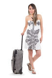 Beautiful young travelling woman with suitcase Stock Photography
