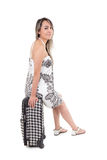 Beautiful young travelling woman with suitcase Royalty Free Stock Photos