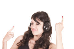 Beautiful young trendy girl using headphones Stock Images