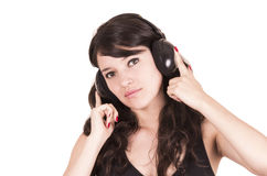 Beautiful young trendy girl using headphones Stock Photos