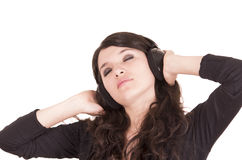 Beautiful young trendy girl using headphones Royalty Free Stock Images