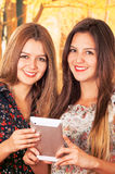 Beautiful young trendy girls using tablet Royalty Free Stock Images