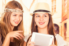 Beautiful young trendy girls using tablet Stock Photos
