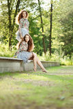 Beautiful young twins outdoors Stock Photography
