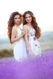 Beautiful young two women over a violet lavender field in Proven Royalty Free Stock Images