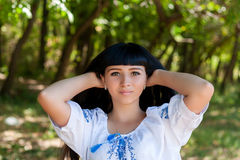 Beautiful young Ukrainian girl in national costume. Girl with beautiful appearance in the woods on the nature. Portrait of beautif Royalty Free Stock Image