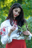 Beautiful young Ukrainian girl in national costume. Girl with beautiful appearance in the woods on the nature. Portrait. Royalty Free Stock Photo