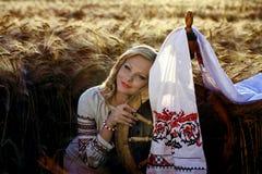 Beautiful young Ukrainian girl in traditional dress Stock Photos