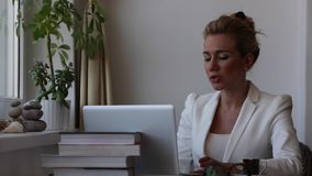 Beautiful young upsetting business woman sitting in front of laptop computer. stock video