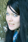 Beautiful young vampire girl. In the forest Stock Photo